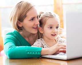 Woman and child using PC