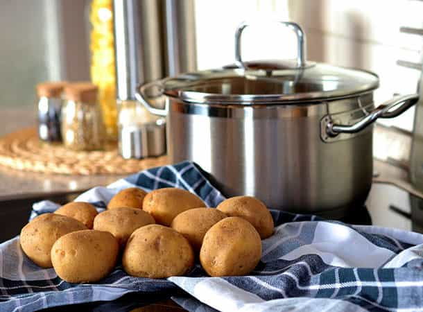 potatoes and a cooking pan in a kitchen situation